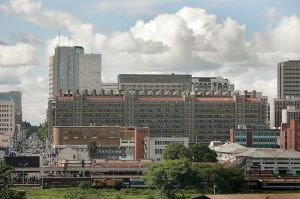 Eastgate Centre (with chimneys on roof) in Harare Zimbabwe. (Source: wikipedia.org. Unknown potographer)